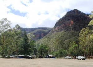 The camping area is surrounded by sandstone topped mountains.