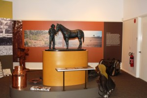 A bronze sculpture of R.M. Williams and horse