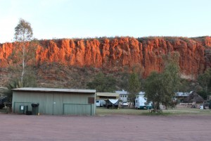 Glen Helen Resort faces the Finke River and the dominating red cliff