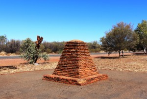 A monument to John McDowell Stuart beside the highway north from Alice Springs. Reminders of Stuart's explorations are scattered through the area