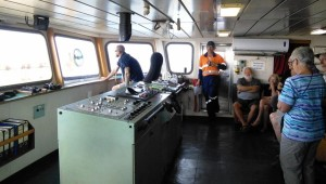 The control area on the bridge. The sailor in the chair is the duty officer.