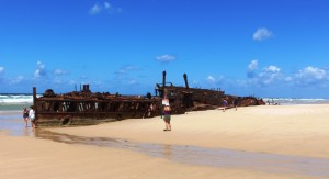 The bones of SS Maheno lie broken in the sand