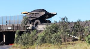 A coal laden dump truck traveling from the mine to the loading facility
