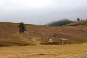 The road runs along the ridge above Bretti camping area