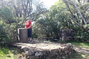 Ruth standing by the trig point at the summit