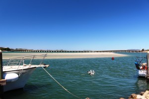The Forster Tuncurry Bridge. A ferry powered by a motor launch that could navigate the sand islands used to carry vehicles over the lake.