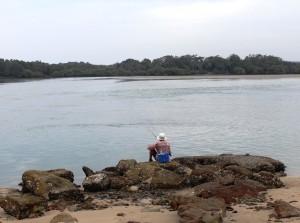 A lone fisherman at Sandon River