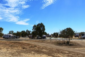 Self contained RVs in residence by the waterhole near Julia Creek
