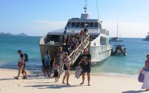 passengers disembarking at Whitehaven Beach