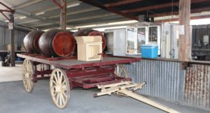Wagon and wine barrels standing beside the bar in the function shed