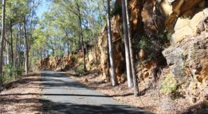 The road that runs at the base of the cliff as the summit is neared