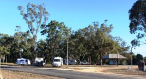 Vans parked at the Isis River camping area
