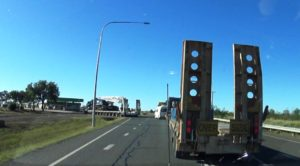 The wide load turning off the highway ahead of us