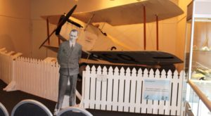 A Bert Hinkler cutout in front of his famous aircraft