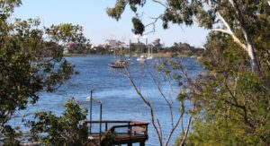 Cruising yachts on the Burnett River. The rum distillery is in the background.