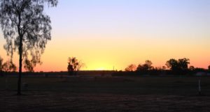 The sun sets over the agricultural fields at Biloela