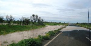 The remaining water over the road was shallow but had obviously been deeper.