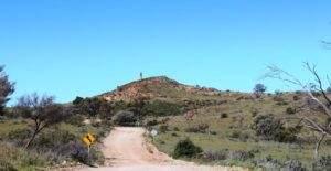 The approach to the Day Dream Silver Mine passes the old smelter flue on the hilltop
