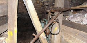 Mining equipment under ground. Visitors can stand at the drill and gain some idea of what it was like to work in the mine.
